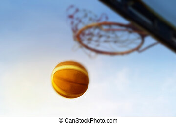 abstract colorful basketball going through the basket, soft and motion blur