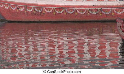 abstract colorful boat reflection on Ganges water background