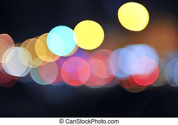 abstract colorful defocused circular facula at night