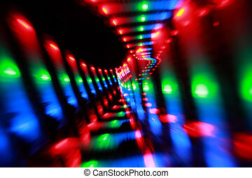 Abstract colorful spots on black background, bright pink, red, green and blue freezelight paint