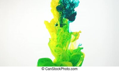 Abstract colourful clouds of ink moving in water, white background. Yellow, green acrylic paint swirling in water. Traces of ink dissolving in water ever changing shape. Shot at 60fps HD format.