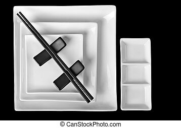 Abstract composition: Asian style tableware. Chopsticks and white plates