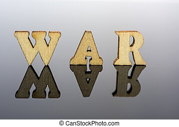Abstract composition of war. Isolated wooden letters and red glass ball.