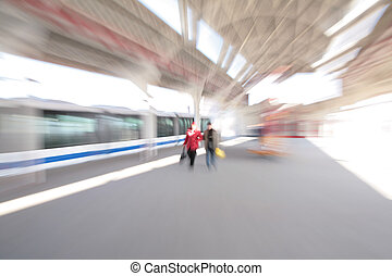 Abstract couple People on train station zoom blur