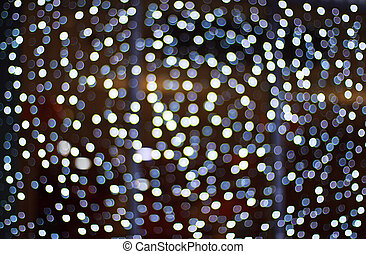 Abstract dark background with white bokeh