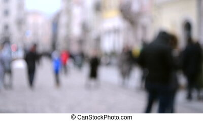 Abstract Defocused Blurred Background of many people on street square old ancient vintage city town with building and paving stones. Backdrop of concept many people traveling rest landmark cityspace