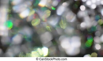 Abstract defocused crystal elements on black background.