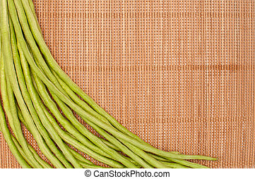 abstract design background vegetables on a bamboo mat background
