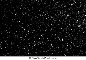 abstract dust particles on dark background