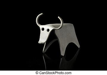 Abstract figurine of a bull made of bent aluminium sheet