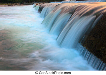 Abstract flowing water from a dam