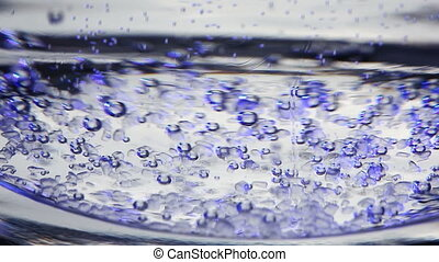 Abstract fluid background with floating blue air bubbles....