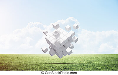Abstract flying white cubes on green meadow
