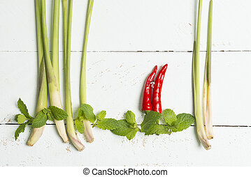Abstract food art-lemon grass, chili, mint and onion painting on white background.