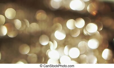 Abstract glittering gold lights, a real shot video in the blur