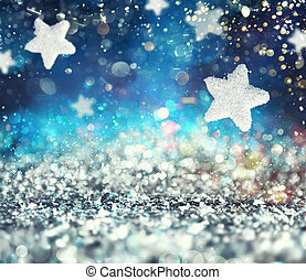 Abstract glowing Christmas blue background with stars