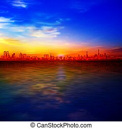 abstract gold sunrise background with blue sky and silhouette of city