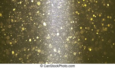 Abstract golden background with beautiful flickering particles. Underwater bubbles in flow with bokeh.