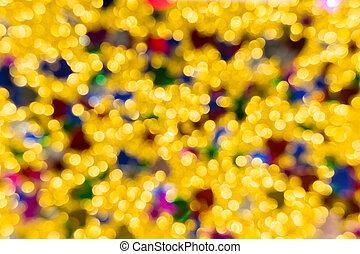 Abstract golden color lights chrismas background. de-focused - image