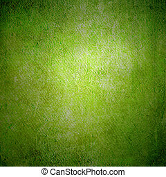 Abstract green background or paper with bright center spotlight and dark border frame with grunge background texture. For vintage layout design of light colorful graphic art
