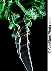 Abstract green smoke. Isolated on a black background