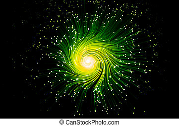 Many illuminated green and yellow fiber optic light strands swirling towards the centre against a black background.