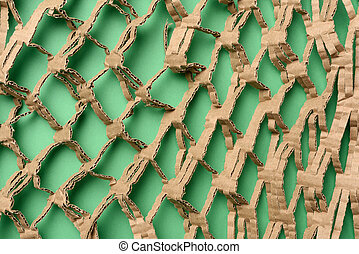 abstract green texture with cut honeycomb brown corrugated paper