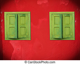 Abstract green windows on red wall