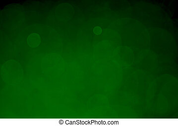 Abstract green yellow bokeh with black background