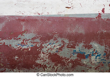 Abstract grunge background maroon stone wall with crumbling plaster.