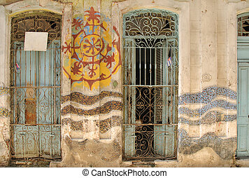 Abstract facade with windows in old Havana street, cuba