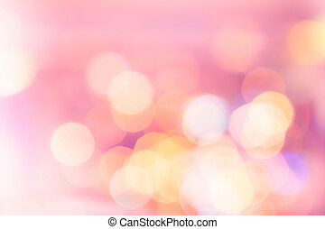 Abstract holiday twinkled bright background with natural bokeh defocused white and pink lights. Festive background.