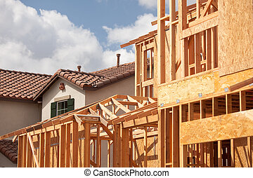 Abstract of New Home Construction Framing And Completed House.
