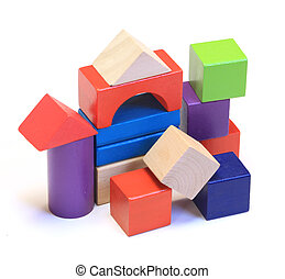 Abstract house made from colorful wooden building blocks isolated on white background