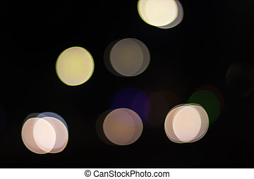 Abstract image of bokeh lights in the city on dark background