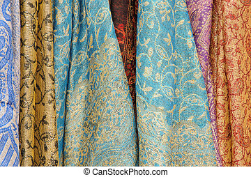 Abstract image of brightly coloured scarves