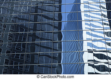 abstract image of modern office building facade with reflections