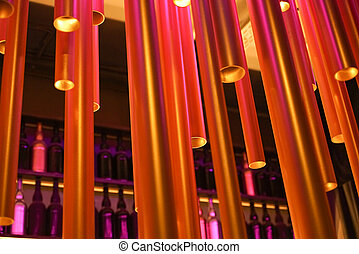 Abstract installation of plastic tubes in the interior. Unusual chandelier.
