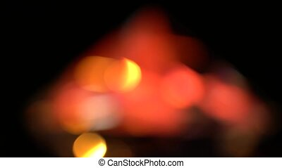 Abstract lights bokeh in yellow red and orange. Black background