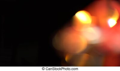 Abstract lights bokeh in yellow red white and orange. Black...