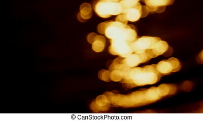 Abstract Lights - Warm flicker of lights on water.