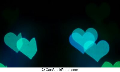 Abstract lights in the shape of a heart on a black screen....