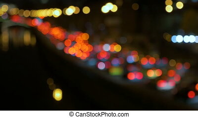 Abstract lights of traffic in the night. Blurred, not in focus, intentionally.