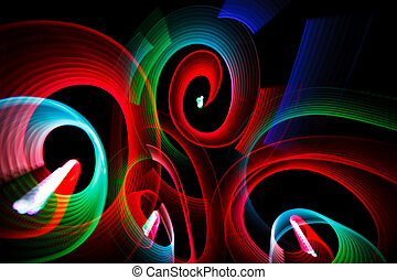 Abstract luminous patterns in form of spirals on black...