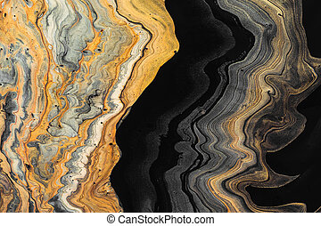 Abstract marble background or texture. Golden waves on black. Acrylic Fluid Art