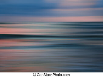 Abstract motion blur sunset nature background on the sea