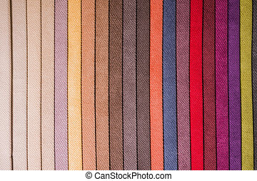 Abstract multicolored background from textiles. Vertical lines of upholstery fabric