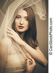 Abstract mysterious portrait girl hidden white behind transparent cloth