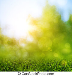 Green grass against abstract natural backgrounds
