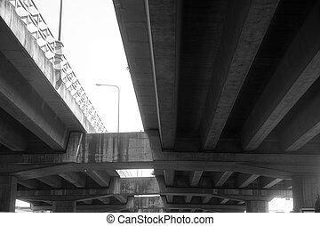 black and white under bridge